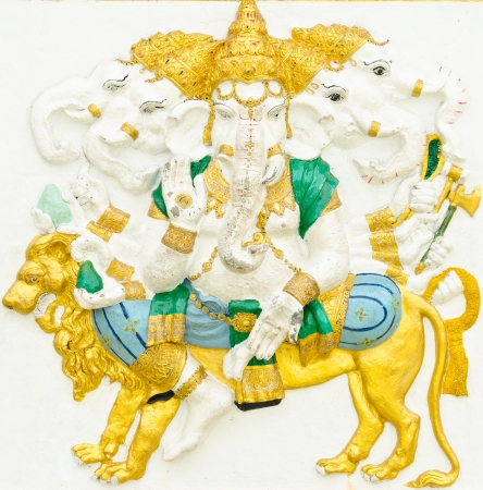 God of success 11 of 32 posture. Indian style or Hindu God Ganesha avatar image in stucco low relief technique with vivid color,Wat Samarn, Chachoengsao,Thailand. Stock Photo - 14834076