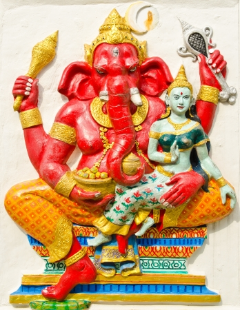 hindu god: God of success 19 of 32 posture. Indian style or Hindu God Ganesha avatar image in stucco low relief technique with vivid color,Wat Samarn, Chachoengsao,Thailand. Editorial