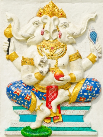 God of success 28 of 32 posture. Indian style or Hindu God Ganesha avatar image in stucco low relief technique with vivid color,Wat Samarn, Chachoengsao,Thailand.