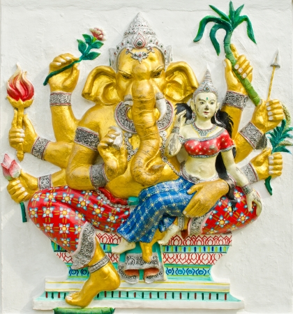 God of success 30 of 32 posture. Indian style or Hindu God Ganesha avatar image in stucco low relief technique with vivid color,Wat Samarn, Chachoengsao,Thailand.