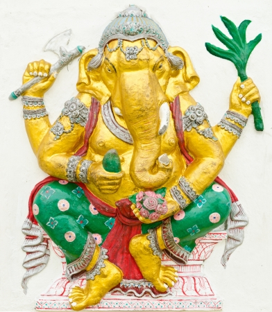 siddhivinayaka: God of success 7 of 32 posture. Indian style or Hindu God Ganesha avatar image in stucco low relief technique with vivid color,Wat Samarn, Chachoengsao,Thailand. Editorial