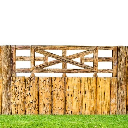 vintage style decorative old wooden fence on flesh grass around the house photo
