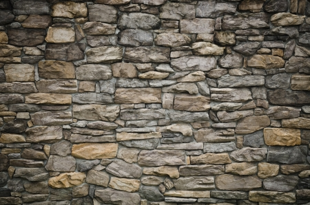 pattern gray color of modern style  design decorative  uneven  cracked real stone wall surface with cement photo