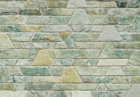 pattern color of modern style  design decorative  green slate stone wall surface with cement in trapezoid shape photo