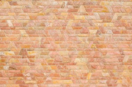trapezoid: patr�n de color del dise�o moderno estilo decorativo rojo pizarra superficie de piedra muro de cemento en forma de trapecio Foto de archivo