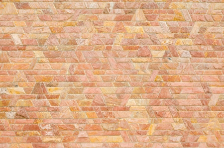 pattern color of modern style  design decorative  red slate stone wall surface with cement in trapezoid shape photo