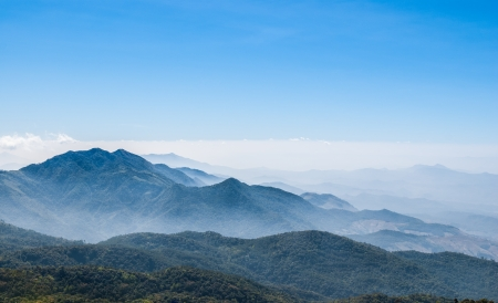 View of Morning Mist at Tropical Mountain Range, Chiang Mai, Thailand photo