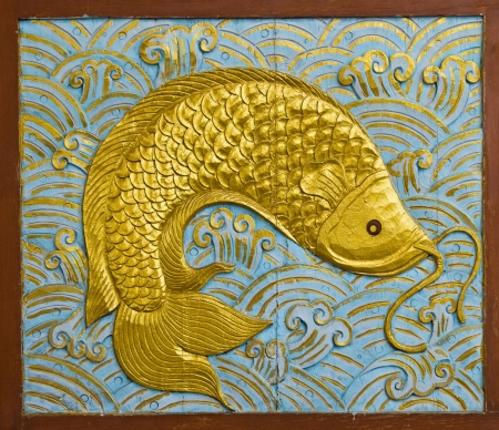 china art: fish carve gold paint in temple wall