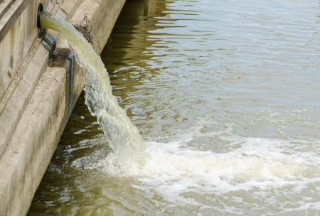 polluting: Photo of flow out water from the conduit of Industrial factory to the river