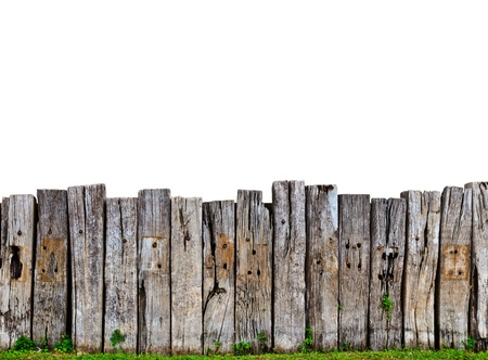picket fence: old wooden fence in garden with plant