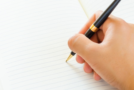 Close up of male hand signing a contract on blank white paper  photo