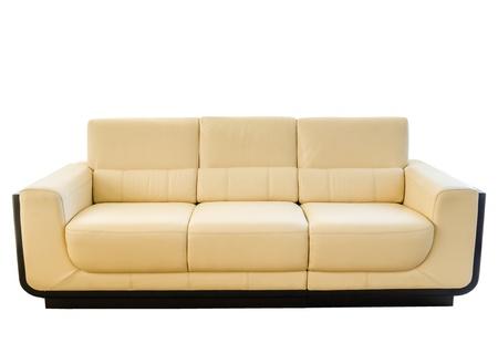 白い背景に対して隔離される現代の白いクリーム色の革のソファのイメージ 写真素材