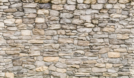 brick mason: pattern gray color of modern style  design decorative  cracked real stone wall surface with cement Stock Photo