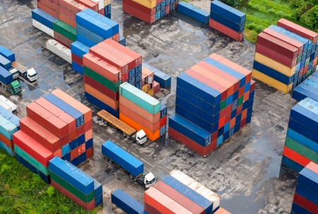 Stack of Freight Containers at the Docks with Truck photo