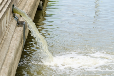 gunk: Photo of flow out water from the conduit of Industrial factory to the river