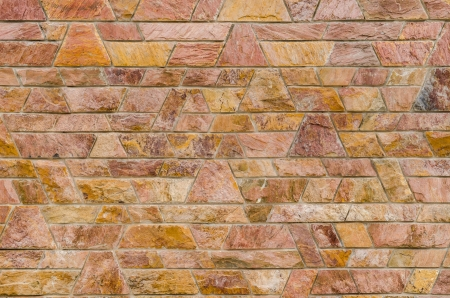 trapezoid: pattern color of modern style design decorative red slate stone wall surface with cement in trapezoid shape