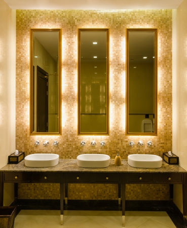 View Modern style interior design of decorative gold mirror frame and lavatory in bathroom