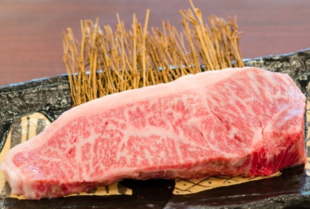 of cattle: Close up Freshness Marbled on Japanese Kobe Matsusaka Beef for BBQ On The Plate in Restaurant  , King of Beef
