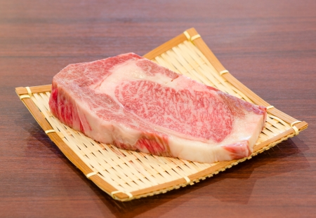 Close up Freshness Marbled on Japanese Kobe Matsusaka Beef for BBQ On The Plate in Restaurant  , King of Beef photo