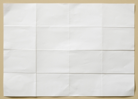 background of white textured sheet of paper folded in sixteen  part for write photo