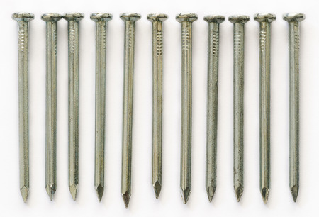 Group of Concrete nails Galvanized dip color on white background photo