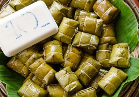 Traditional Thai food style, Glutinous rice steamed in banana leaf ( Khao Tom Mat or Khao Tom Pad ) bananas and sticky rice inside in market at Thailand photo