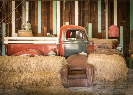 background interior design of an old country house, decorating brown sofa and red pickup inside the room