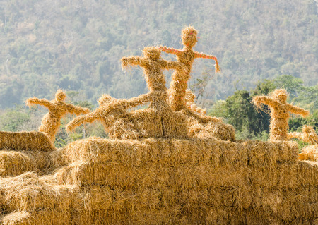 Group of scarecrows stand together in the garden photo
