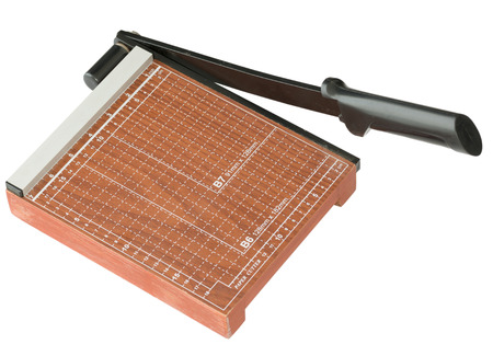 guillotine: Close up Wooden Paper cutter in brown color isolated on white background
