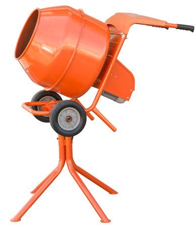 concrete mixer: small orange concrete mixer machine and wheelbarrow isolate on white background