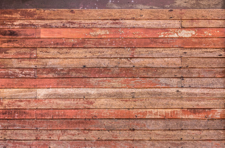 background pattern detail of old red wood strip texture on decorative  surface wall photo