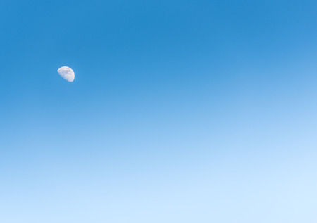waxing gibbous: natural scenes of the moon in the day on blue sky Stock Photo