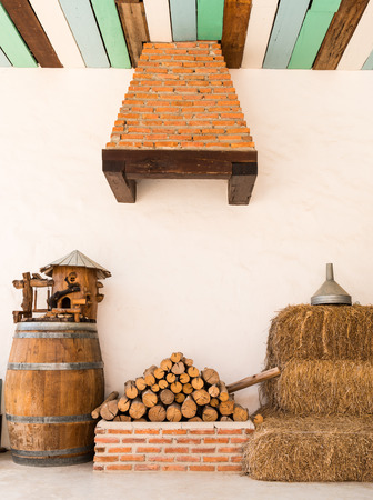 close up pile of firewood material on a farmhouse background photo