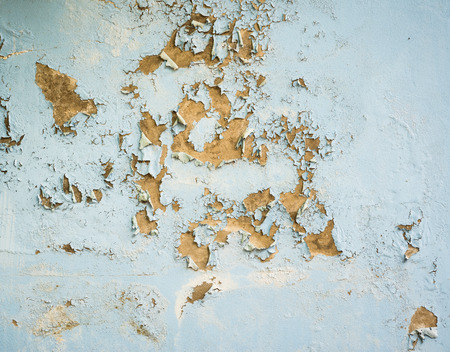close up background and texture of peeling paint on pastering wall because moisture of water photo