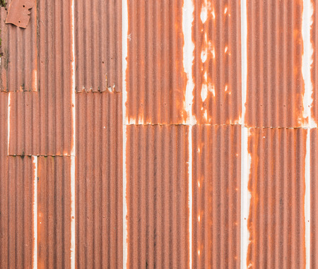 close up a rusty corrugated iron metal sheet texture of old roof on building photo