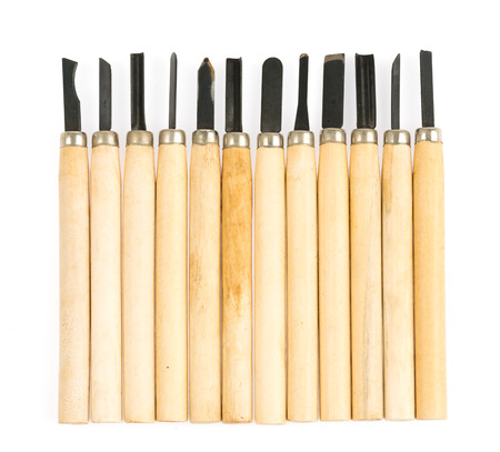 close up art and craft tools on white background, wood carving tool photo
