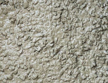 Close up background and texture of mixed fresh concrete on construction site photo