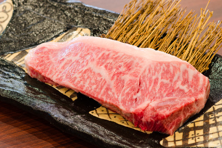 animal blood: Close up Freshness Marbled on Japanese Kobe Matsusaka Beef for BBQ On The Plate in Restaurant  , King of Beef