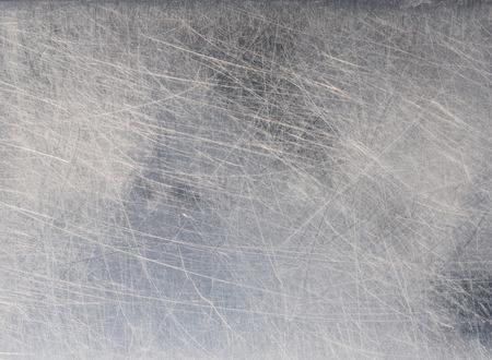 背景とステンレス金属表面のテクスチャを砂で傷を閉じる