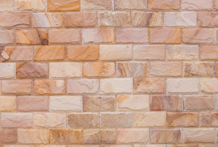 background and texture vintage style of decorative  brown color nature real stone wall photo