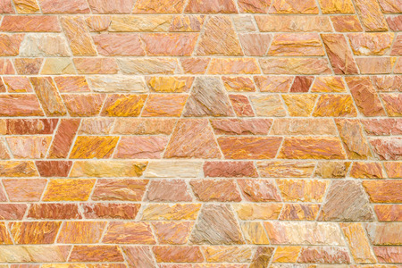 trapezoid: pattern color of modern style  design decorative  red slate stone wall surface with cement in trapezoid shape Stock Photo
