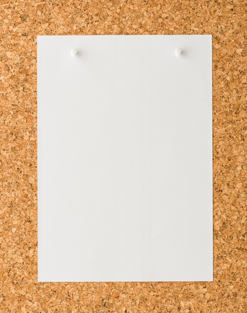 cork sheet: close up Blank white paper note sheet with white push pin on cork board background for write memo