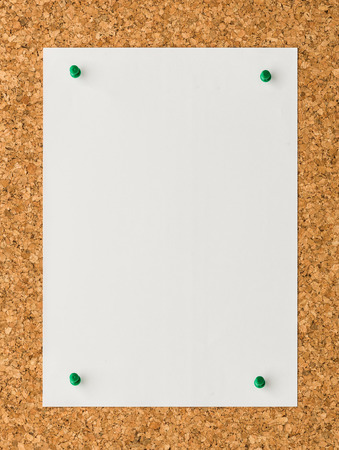 cork sheet: close up Blank white paper note sheet with green push pin on cork board background for write memo