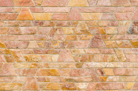 trapezoid: pattern color of modern style  design decorative  red slate stone wall surface with cement in trapezoid shape Foto de archivo