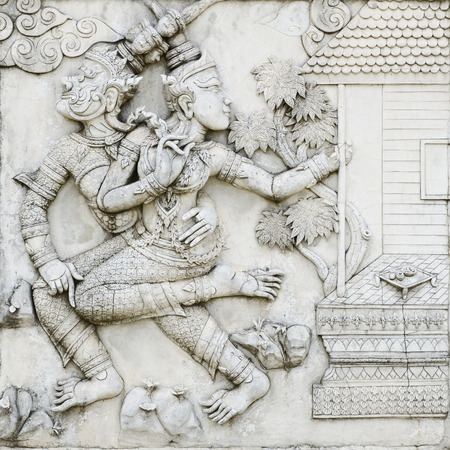 decorative wall: masterpiece of traditional Thai style stucco art old about Ramayana story on temple decorative wall at Wat Panan Choeng temple, Ayutthaya, Thailand. World Heritage Site