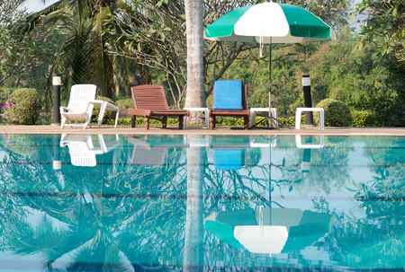 chair garden: Beach chairs and umbrella side swimming pool