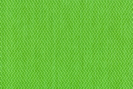 criss cross: close up green background curtain of criss cross fabric texture detail Stock Photo