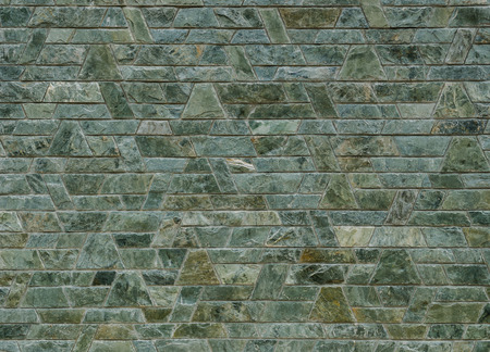 trapezoid: pattern color of modern style design decorative green slate stone wall surface with cement in trapezoid shape