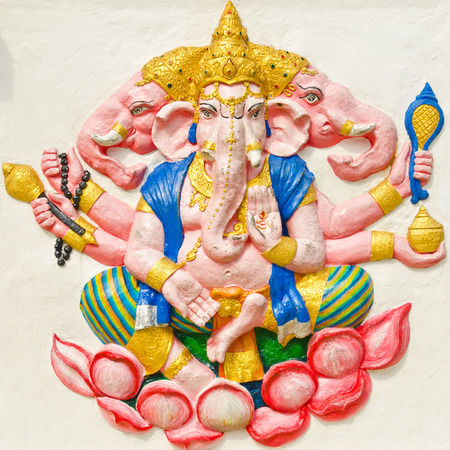 god ganesh: God of success 29 of 32 posture. Indian style or Hindu God Ganesha avatar image in stucco low relief technique with vivid color,Wat Samarn, Chachoengsao,Thailand.