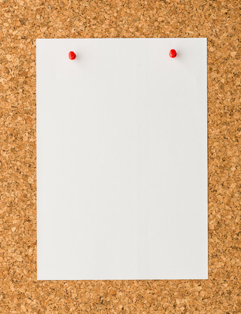 cork sheet: close up Blank white paper note sheet with red push pin on cork board background for write memo